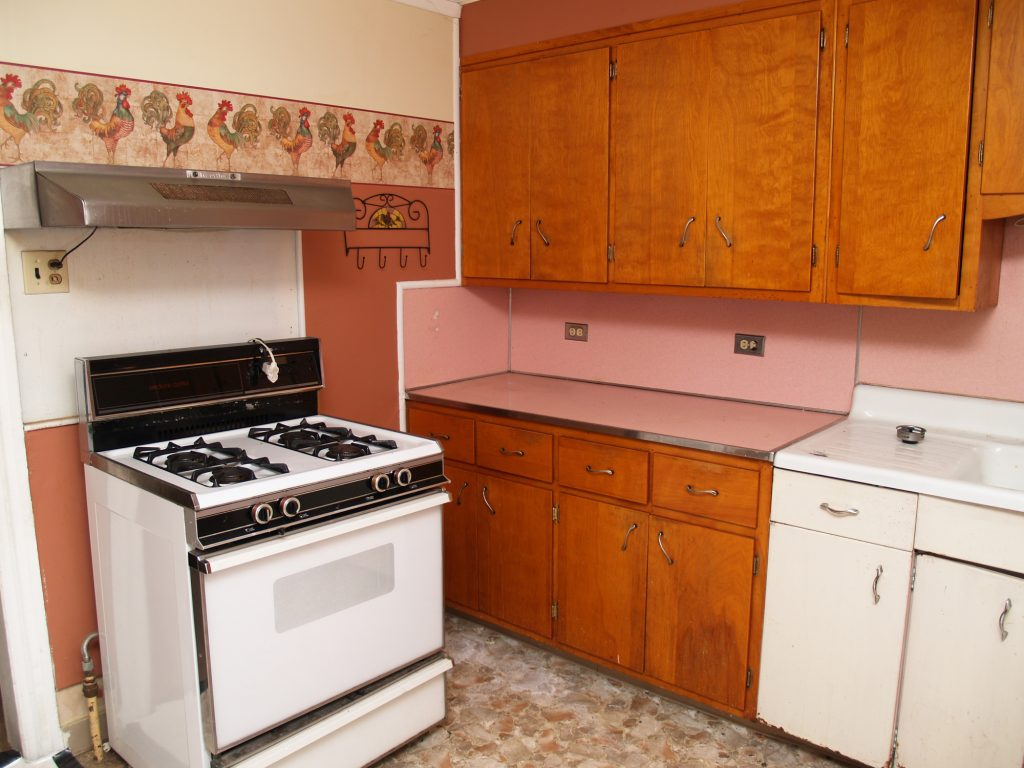 Worn Cabinets: When to Refinish and When to Paint