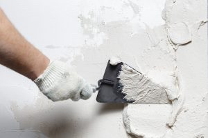 DIY Stucco Repair: Repairing and Sealing Cracks and Holes